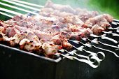 stock photo of frizzle  - Preparation of meat slices in sauce on fire - JPG