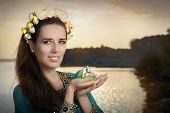 foto of fragrance  - Portrait of a glamorous woman with retro fragrance recipient in seaside landscape - JPG