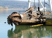 pic of dredge  - rotor with blade of a big dredge in a channel - JPG