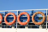 stock photo of life-boat  - orange life buoys in a deck of a boat - JPG