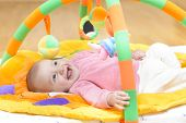 picture of innocence  - Innocent baby smiling and playing with toys - JPG