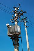 stock photo of transformer  - Pylons with electric wires and distribution transformer - JPG