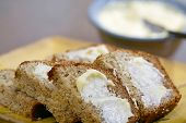 stock photo of fresh slice bread  - Freshly baked and sliced banana bread with butter - JPG