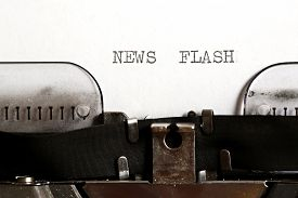 pic of flashing  - News flash written on an old typewriter  - JPG