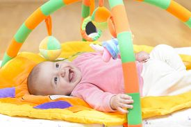 image of playmate  - Innocent baby smiling and playing with toys - JPG
