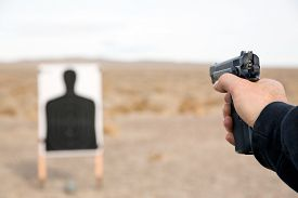 picture of shooting-range  - Target shooting with handgun on remote location - JPG