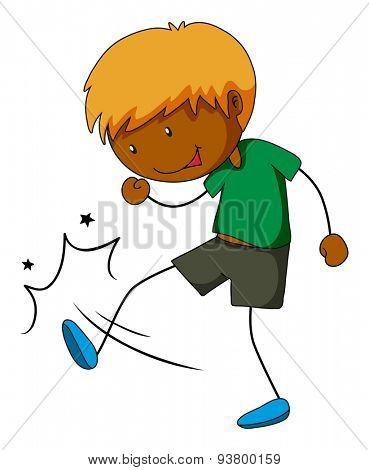 Boy in green shirt kicking something