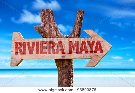 Riviera Maya wooden sign with beach background