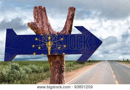 Indiana Flag wooden sign with road background