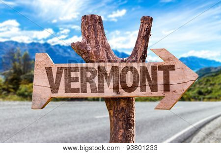 Vermont wooden sign with road background