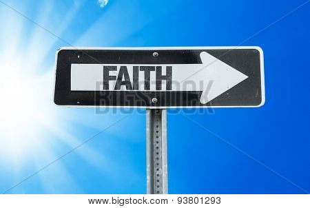 Faith direction sign with a beautiful day
