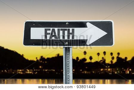 Faith direction sign with sunset background