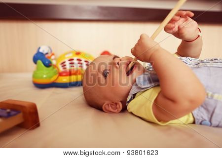 Small Kid Playing With Drum Stick