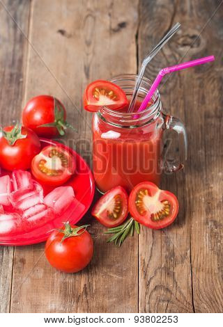 Fresh tomatoes and a glass of tomato juice