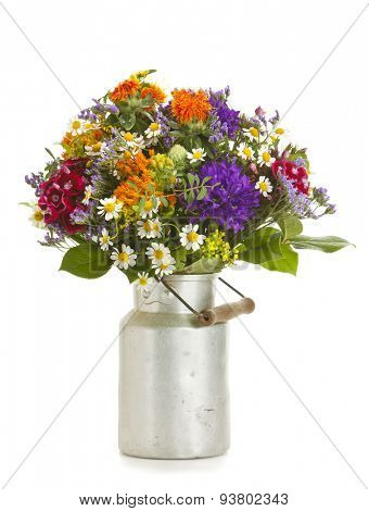 Beautiful bouquet of summer flowers in old milk canister isolated on white