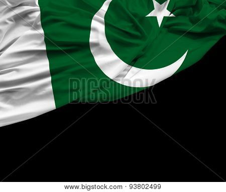 Pakistani waving flag on black background