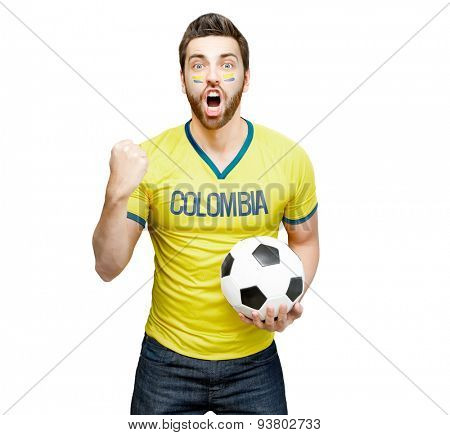 Colombian fan holding a soccer ball celebrates on white background