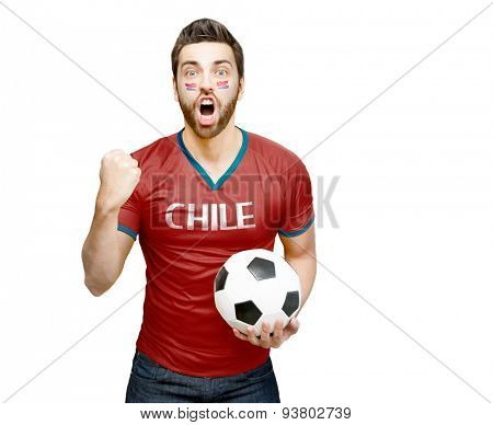 Chilean fan holding a soccer ball celebrates on white background