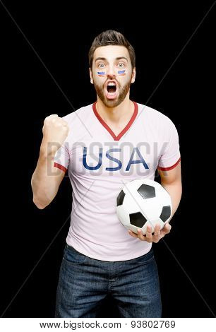 American fan holding a soccer ball celebrates on black background