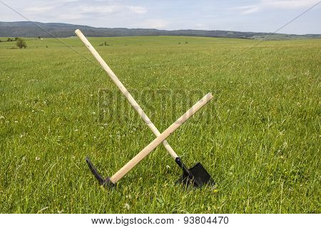 Shovel And Pickaxe Stuck In The Ground