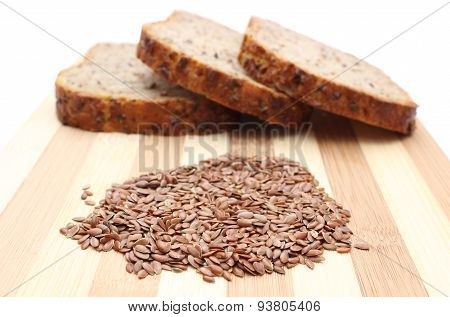 Linseed On Cutting Board And Slices Of Wholemeal Bread