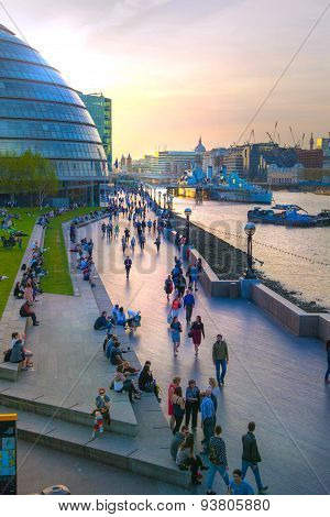 LONDON, UK - APRIL15, 2015:  City of London, south bank of river Thames with lots of walking people
