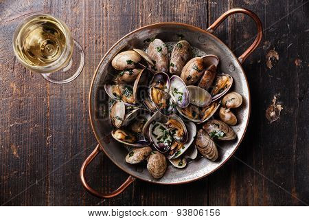 Shells Vongole Venus Clams In Copper Cooking Dish And Wine On Dark Wooden Background