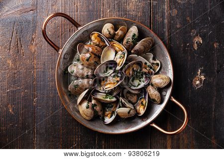 Shells Vongole Venus Clams In Copper Cooking Dish On Dark Wooden Background