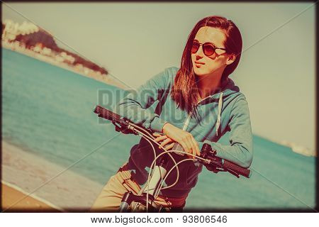 Smiling Girl With A Bike On Summer Beach