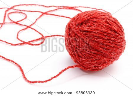 Closeup Of Entangled Red Wool On White Background