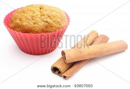 Fresh Baked Carrot Muffin And Cinnamon Stick. White Background