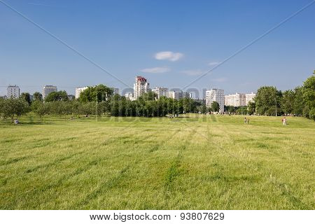 People Have Rest On The Lawn In The City Park Kolomenskoe
