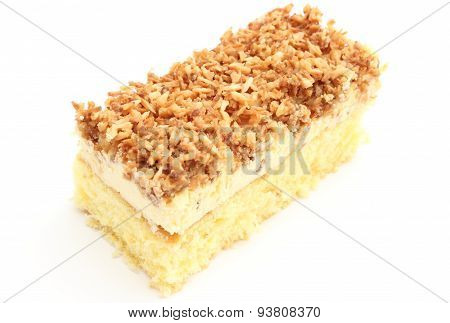 Sponge Cake With Cream And Coconut. White Background