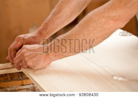 Man's Hand Working On Wood