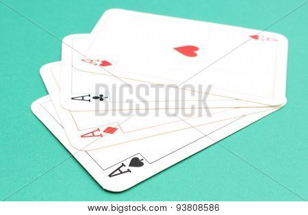 Composition Of Four Aces On Green Background