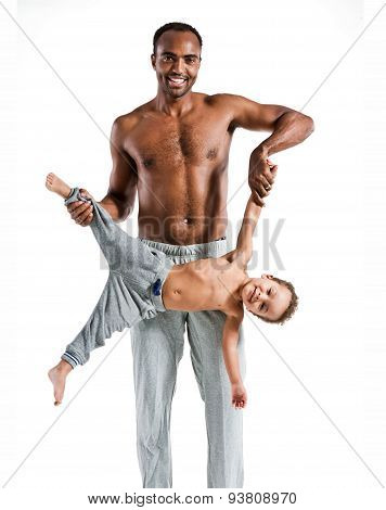 Young Father Having Fun With His Child, Family And Father's Day Concept