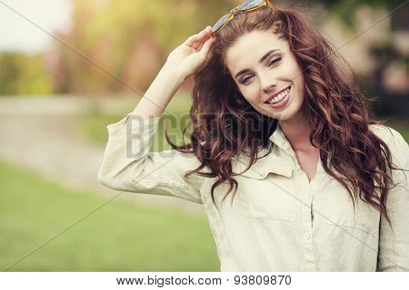 Smiling summer woman with sunglasses in italian garden