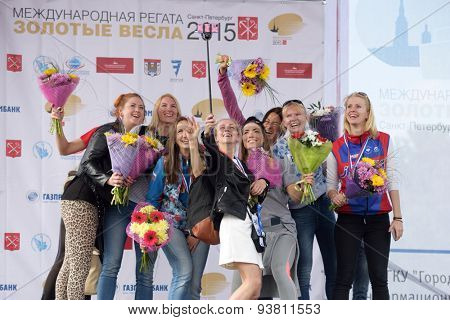 ST. PETERSBURG, RUSSIA - JUNE 12, 2015: Winners of sweep rowing competitions on eights boat during the medal ceremony of Golden Blades Regatta. It is is one of the best known regatta in Russia
