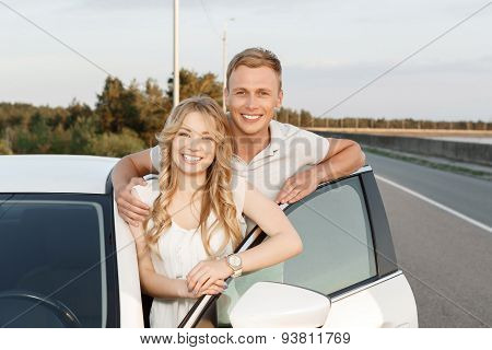 Lovely couple near the car