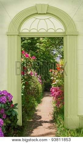 View Through Arched Door, Blooming Rhododendrons
