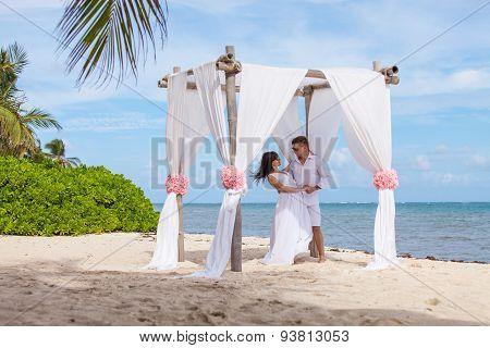 Young Loving Couple Wedding In Gazebo.