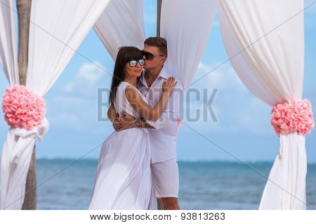 Young Loving Couple Wedding In Gazebo.