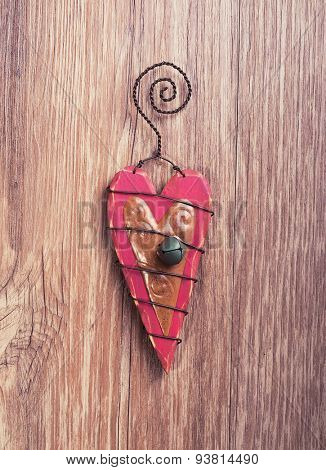 christmas wooden decorations  heart and christmas bell hanging on wooden background