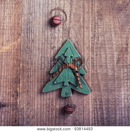 christmas wooden decorations christmas tree hanging on wooden background