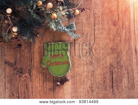 christmas wooden decorations - palm and christmas tree hanging on rope in front of wooden background