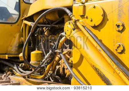 Yellow Industrial Machines Engine Compartment