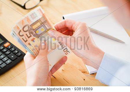 Accountant Counting Euros