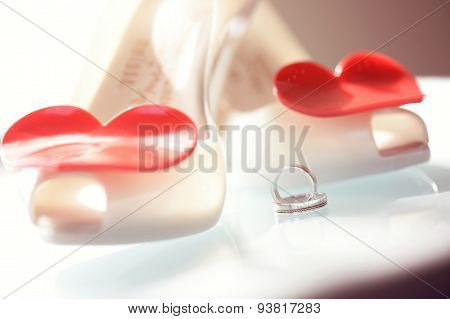 Beautiful Wedding Rings Near Wedding Shoes With Heart Shape