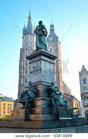 The statue of Adam Mickiewicz and St. Mary's Church on the main square in Krakow.
