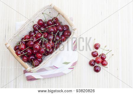 Fresh cherries in wicker basket